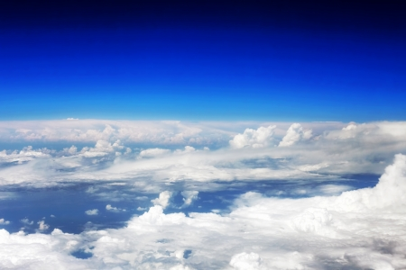 Beautiful view above the earth at the clouds below. Stock Photo - 14503558