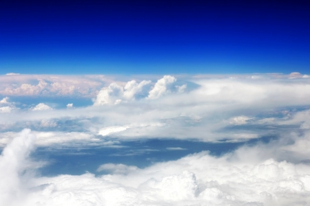 Beautiful view above the earth at the clouds below. Stock Photo - 14503556