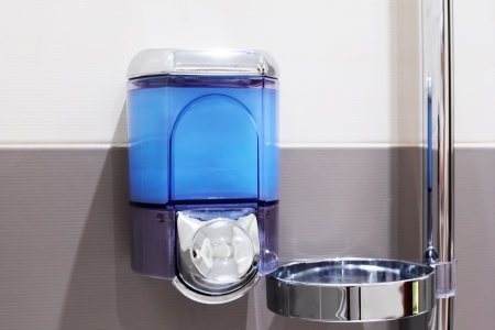 Faucet with soap dispenser in bathroom. Stock Photo - 14714136