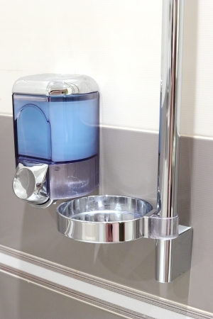 Faucet with soap dispenser in bathroom. Stock Photo - 14968082