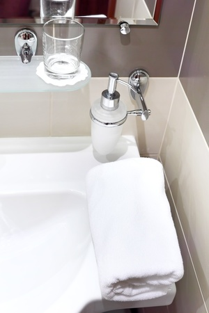 Faucet with soap dispenser in bathroom. Stock Photo - 14968093