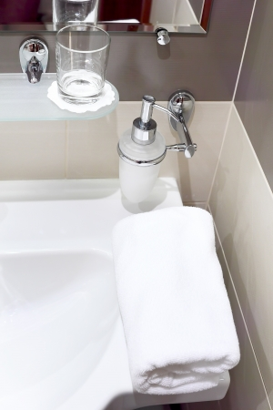 faience: White  sink and towell in SPA salon. Stock Photo