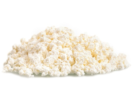 Fresh cottage cheese  curd  heap, isolated on white background  photo