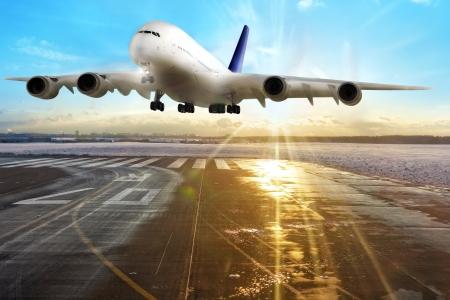 to depart: Passenger airplane landing on runway in airport  Evening