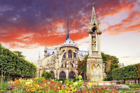 Notre Dame de Paris Cathedral, garden with flowers Paris  France photo