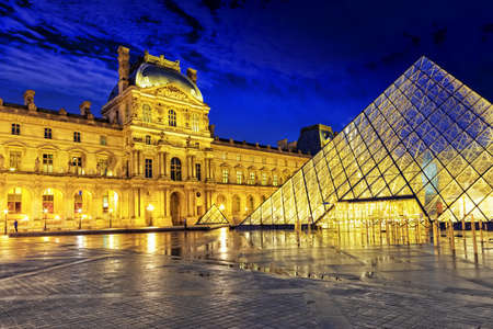 nearly: PARIS - SEPTEMBER 17. Glass pyramid and the Louvre museum on September, 17, 2013. The Louvre is the biggest museum in Paris with nearly 35,000 objects from prehistory to the 19th century . Stock Photo