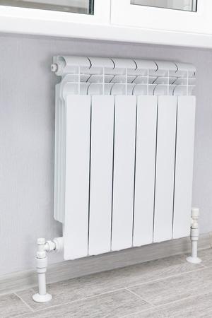 bimetallic: Heating white radiator radiator in living room.