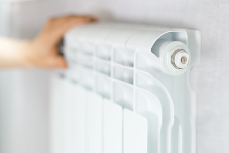 Arm put on  heating white radiator