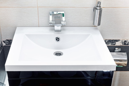 rustproof: White sink and soap dispenser