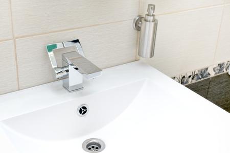 rustproof: Chromium-plate tap on white sink