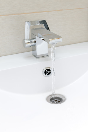 Chromium-plate tap with water photo