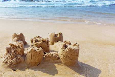 castle: Destroyed sand castle on a beach. Spain