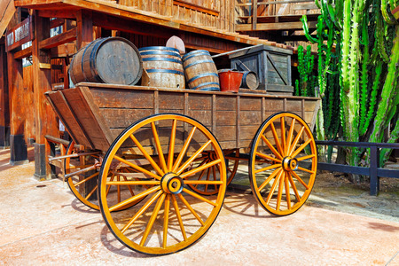 winy: Old cart with wine barrels.Wild West.
