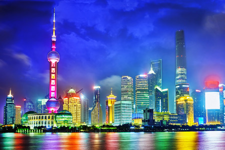 pudong: Skyline night  view from Bund waterfront on Pudong New Area- the business quarter of the Shanghai. Stock Photo