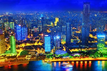 broadway tower: Beautiful view of  Shanghai -  Bund or Waitan waterfront at night. Shanghai waterfront Bund has historical buildings and it is one of the most famous tourist places in Shanghai. Stock Photo