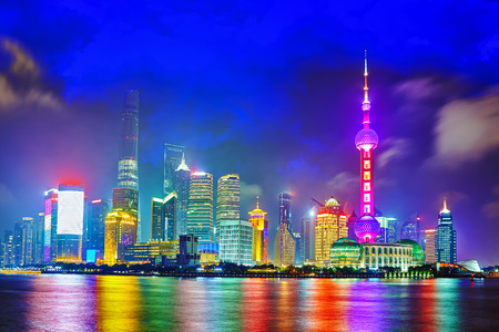 shanghai pudong skyline: Skyline night  view from Bund waterfront on Pudong New Area- the business quarter of the Shanghai. Stock Photo