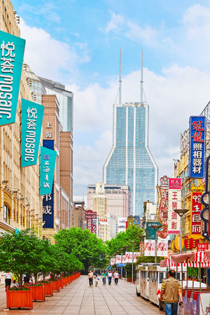 broadway tower: SHANGHAI, CHINA - MAY 24, 2015:Beautiful view of Shanghai street Nanjing Lu. Shanghai street Nanjing Lu has many modern malls, shops, cafes, restaurants and places for interesting spend a time. Editorial