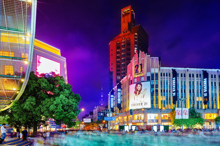 broadway tower: SHANGHAI, CHINA - MAY 23, 2015:Beautiful view of Shanghai street Nanjing Lu. Shanghai street Nanjing Lu has many modern malls, shops, cafes, restaurants and places for interesting spend a time. Editorial
