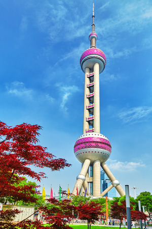 Oriental Pearl Tower on  blue sky background. Tower 470 meter the Oriental Pearl is one of Shanghais tallest buildings.