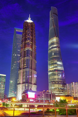 urban street: Beautiful and office skyscrapers,night view city building of Pudong, Shanghai, China.