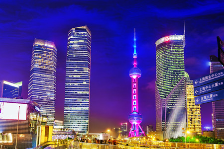 pudong district: SHANGHAI-MAY 24, 2015. Oriental Pearl Tower at the nighttime. Tower  470 meter the Oriental Pearl is one of Shanghais tallest buildings, located at Lujiazui finance and trade zone in Pudong district in most dynamic city of China.