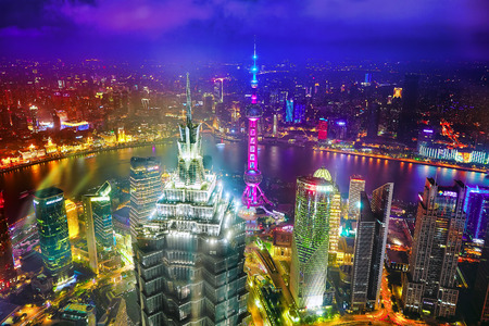 pudong district: SHANGHAI, CHINA -MAY 24, 2015. Oriental Pearl Tower at the nighttime. Tower  470 meter the Oriental Pearl is one of Shanghais tallest buildings, located at Lujiazui finance and trade zone in Pudong district in most dynamic city of China.ghai, China.