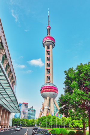oriental pearl tower: SHANGHAI-MAY 24, 2015. Oriental Pearl Tower on  blue sky background. Tower  470 meter the Oriental Pearl is one of Shanghais tallest buildings, located at Lujiazui finance and trade zone in Pudong district in most dynamic city of China. Editorial