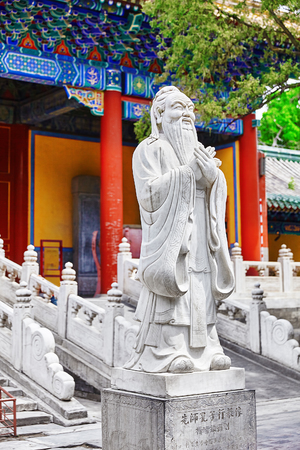 philosopher: Statue of Confucius, the great Chinese philosopher in Temple of Confucius at Beijing.China. Stock Photo