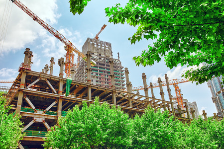 modern residential building: Skyscraper Building under construction in summer day. Stock Photo