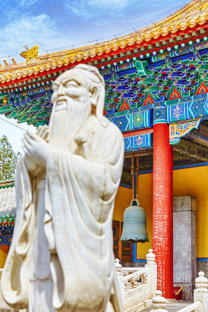 philosopher: Statue of Confucius, the great Chinese philosopher in Temple of Confucius at Beijing.China.Focus on the background.