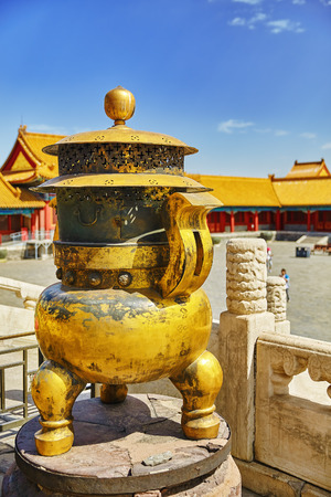 temple tank: Copper bowl  inside territory of the Forbidden City Museum in Beijing, in the heart of city,China.