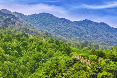 regenerated: Not restoration- not recovered, authentic view of time-destroyed Great Wall of China, section Mitianyu. Suburbs of Beijing.