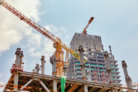 multifamily: Skyscraper Building under construction in summer day. Stock Photo