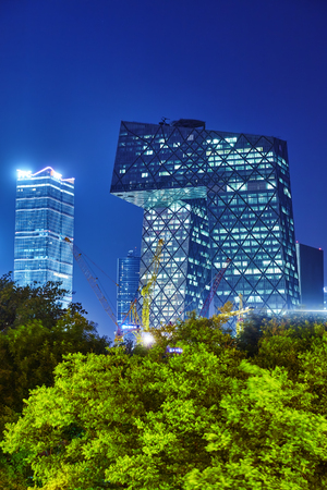 megapolis: BEIJING, CHINA - MAY 20, 2015:Evening, night modern Beijing business quarter of the capital, the streets of the city with beautiful skyscrapers. Beijing. China Editorial
