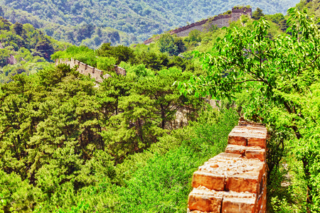 simatai: Not restoration- not recovered, authentic view of time-destroyed Great Wall of China, section Mitianyu. Suburbs of Beijing.