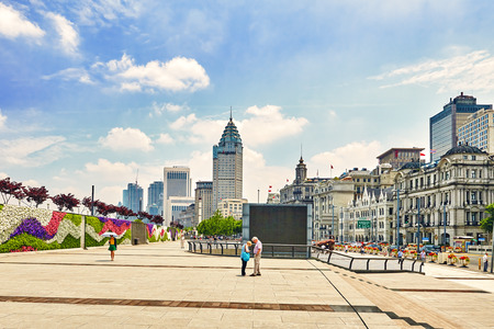 broadway tower: SHANGHAI, CHINA - MAY 25,2015:Beautiful view of Shanghai -  Bund or Waitan waterfront. Shanghai waterfront Bund has historical buildings and it is one of the most famous tourist places in Shanghai.