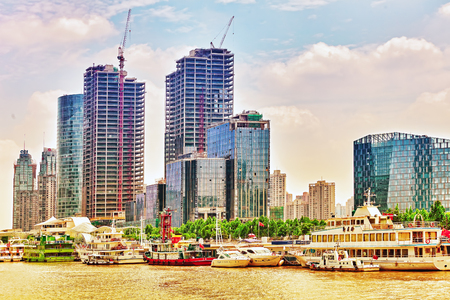 shantytown: SHANGHAI-MAY 24, 2015. Skyline view from Bund waterfront on Pudong New Area- the business quarter of the Shanghai. Shanghai district in most dynamic city of China.