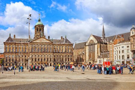 dam square: AMSTERDAM, NETHERLANDS - SEPTEMBER 15, 2015:Royal Palace in Amsterdam on the Dam Square in the evening. Netherlands Editorial