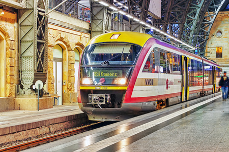 intercity: DRESDEN,GERMANY-SEPTEMBER 08,2015: Intercity train at the railways station of Dresden.Rail transport in Germany is at a very high level of progress. Saxony, Germany.