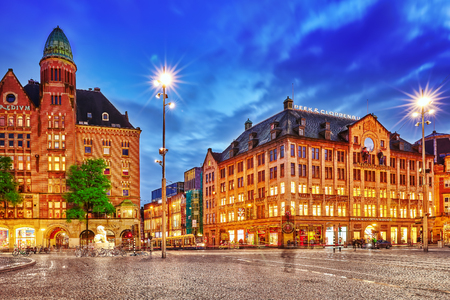 dam square: AMSTERDAM, NETHERLANDS - SEPTEMBER 15, 2015: Beautiful Amsterdam, centre of  Dam Square in the evening. Square is a central place for local inhabitants and tourists of the Dutch capital. Netherlands Editorial