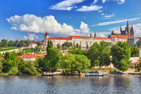 st nicholas cathedral: View of Prague Castle from waterfront- famous historic bridge that crosses the Vltava river in Prague, Czech Republic. Editorial