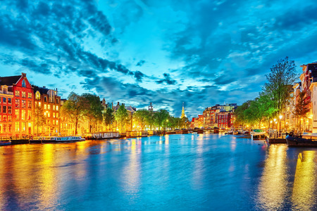 river boat: Famous Amstel river and night view of beautiful Amsterdam city. Netherlands