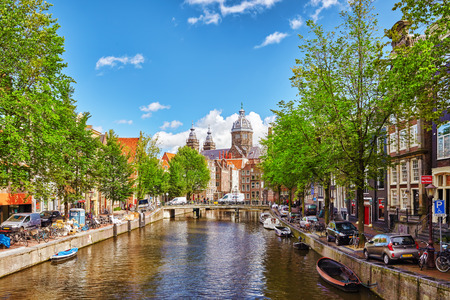 river       water: AMSTERDAM, NETHERLANDS- SEPTEMBER 15, 2015: Westerkerk (Western Church), with water canal view in Amsterdam. Netherlands. Editorial