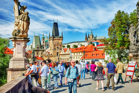 st nicholas cathedral: PRAGUE,CZECH REPUBLIC- SEPTEMBER 13, 2015: View of Prague Castle and Charles Bridge with people -famous historic bridge that crosses the Vltava river in Prague, Czech Republic.