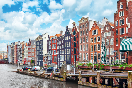 Beautiful views of the streets, ancient buildings, people, embankments of Amsterdam - also call