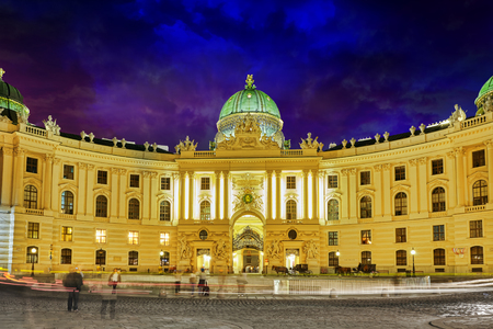 hofburg: Hofburg Palace seen from Michaelerplatz, wide-angle view at dusk.Vienna.Austria. Editorial