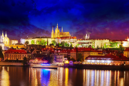 st nicholas cathedral: View of Prague Castle from waterfront  Vltava river in Prague.Czech Republic.
