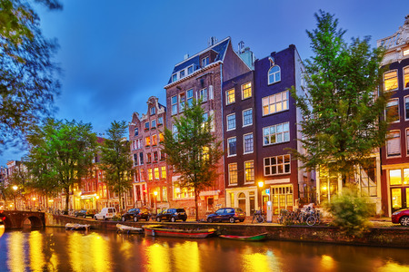 AMSTERDAM, NETHERLANDS-SEPTEMBER 15, 2015:Beautiful Amsterdam city, canals at the evening time. Netherlands