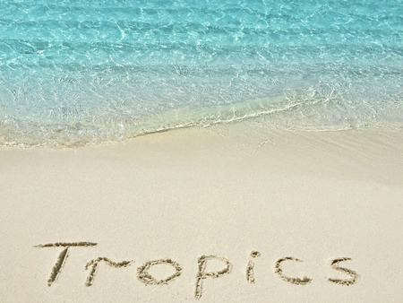 timeshare: Inscription Tropics in the sand on a tropical island,  Maldives.