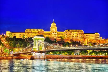 szechenyi: Budapest Royal Castle and Szechenyi Chain Bridge at dusk time from Danube river, Hungary